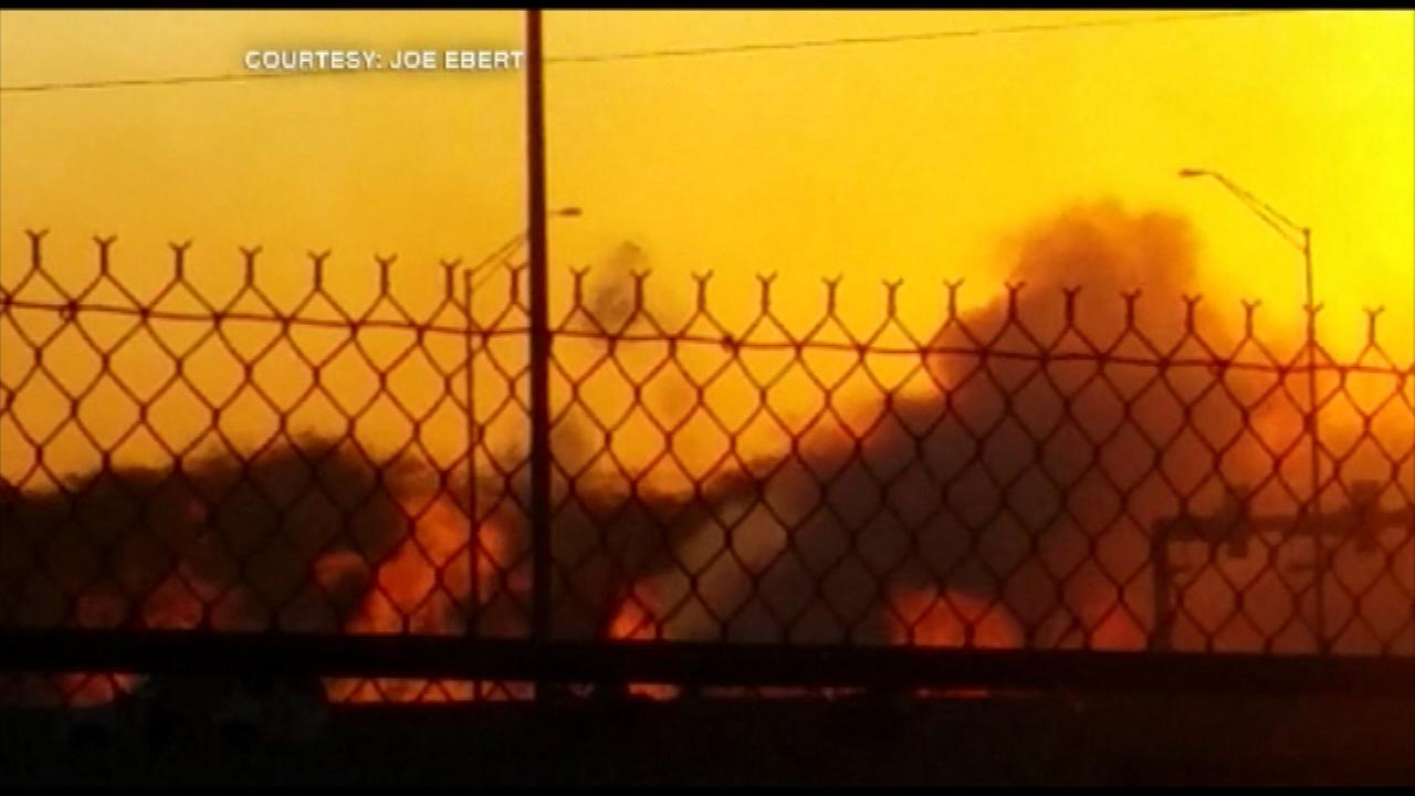 A large fire is impacting traffic on a busy expressway in the southwest suburbs Monday night.