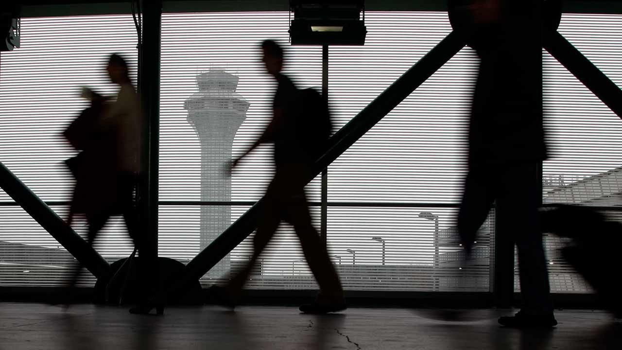 (FILE) Passengers walk through Terminal 3 at OHare International Airport in Chicago on Saturday, Dec. 21, 2013.