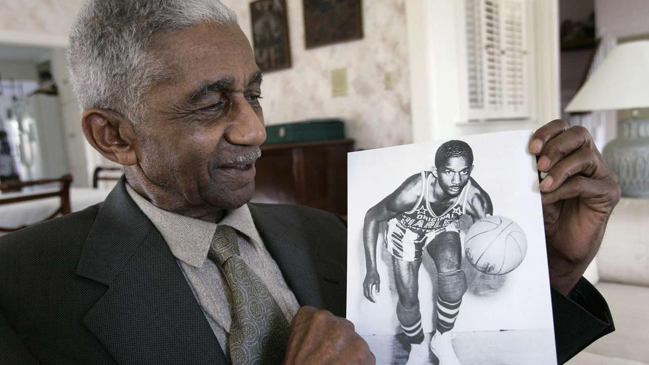 Former Harlem Globetrotters great Marques Haynes holds a photo circa 1951 of himself in his Globetrotters uniform on Feb. 14, 2008, in Plano, Texas.
