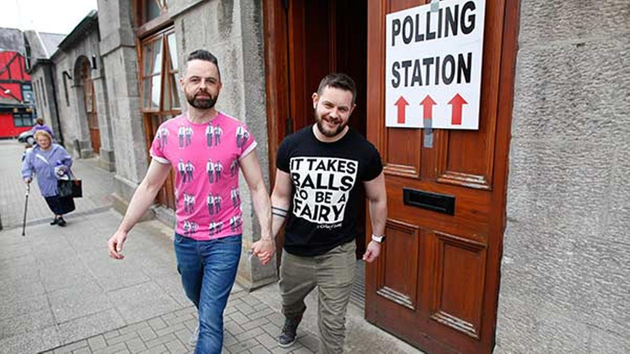 Partners Adrian, left, and Shane, leave a polling station after casting their vote in Drogheda, Ireland on May 22, 2015.