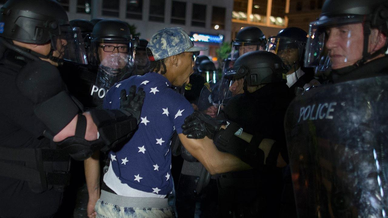 A demonstrator is arrested during a march against the acquittal of Michael Brelo, a patrolman charged in the shooting deaths of two unarmed suspects, on May 23, 2015, in Cleveland.AP Photo/John Minchillo