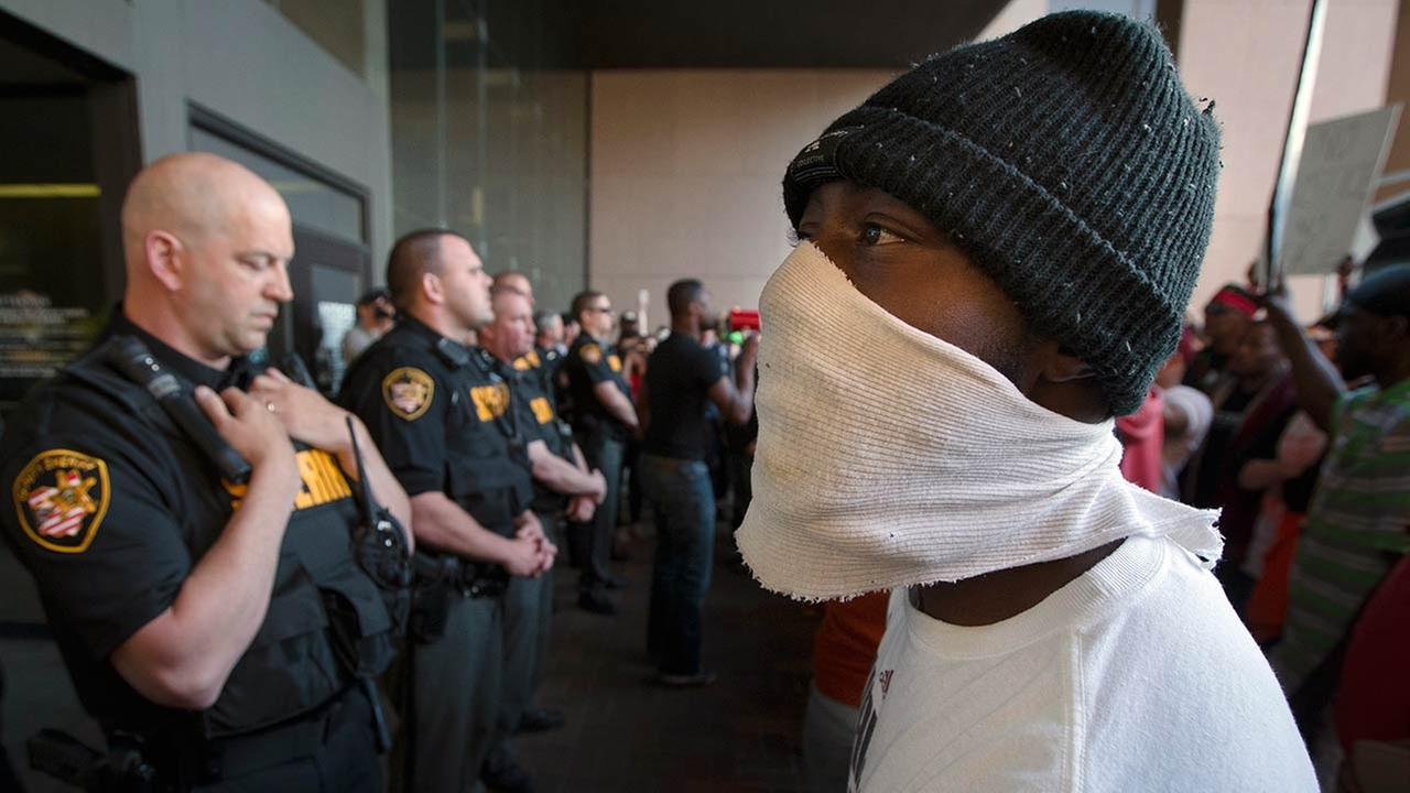 Demonstrators at the entrance to the Cuyahoga County Justice Center as police stand guard during a protest against the acquittal of Michael Brelo on May 23, 2015, in Cleveland.AP Photo/John Minchillo