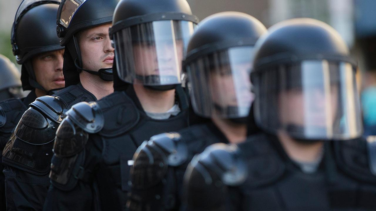 Riot police stand in formation as a protest forms against the acquittal of Michael Brelo, a patrolman charged in the shooting deaths of two unarmed suspects, on May 23, 2015.