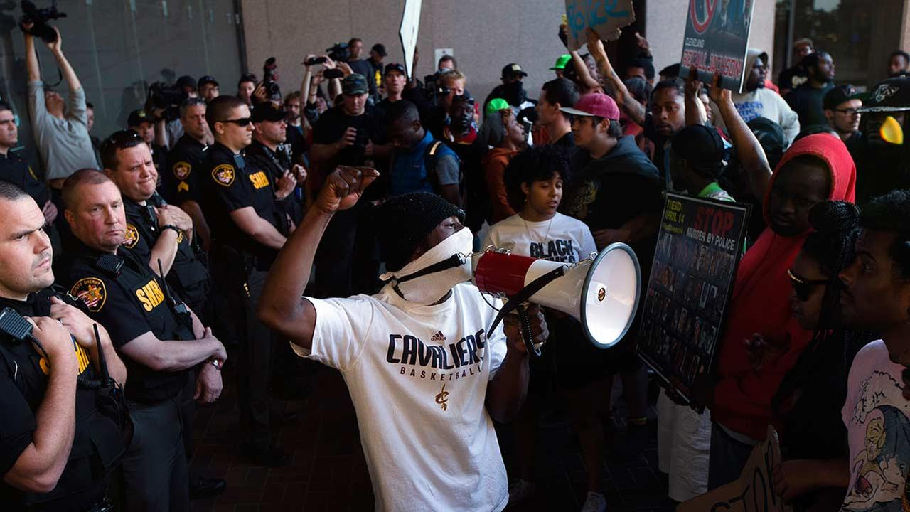 Demonstrators at the entrance to the Cuyahoga County Justice Center as police stand guard during a protest against the acquittal of Michael Brelo on May 23, 2015, in Cleveland.
