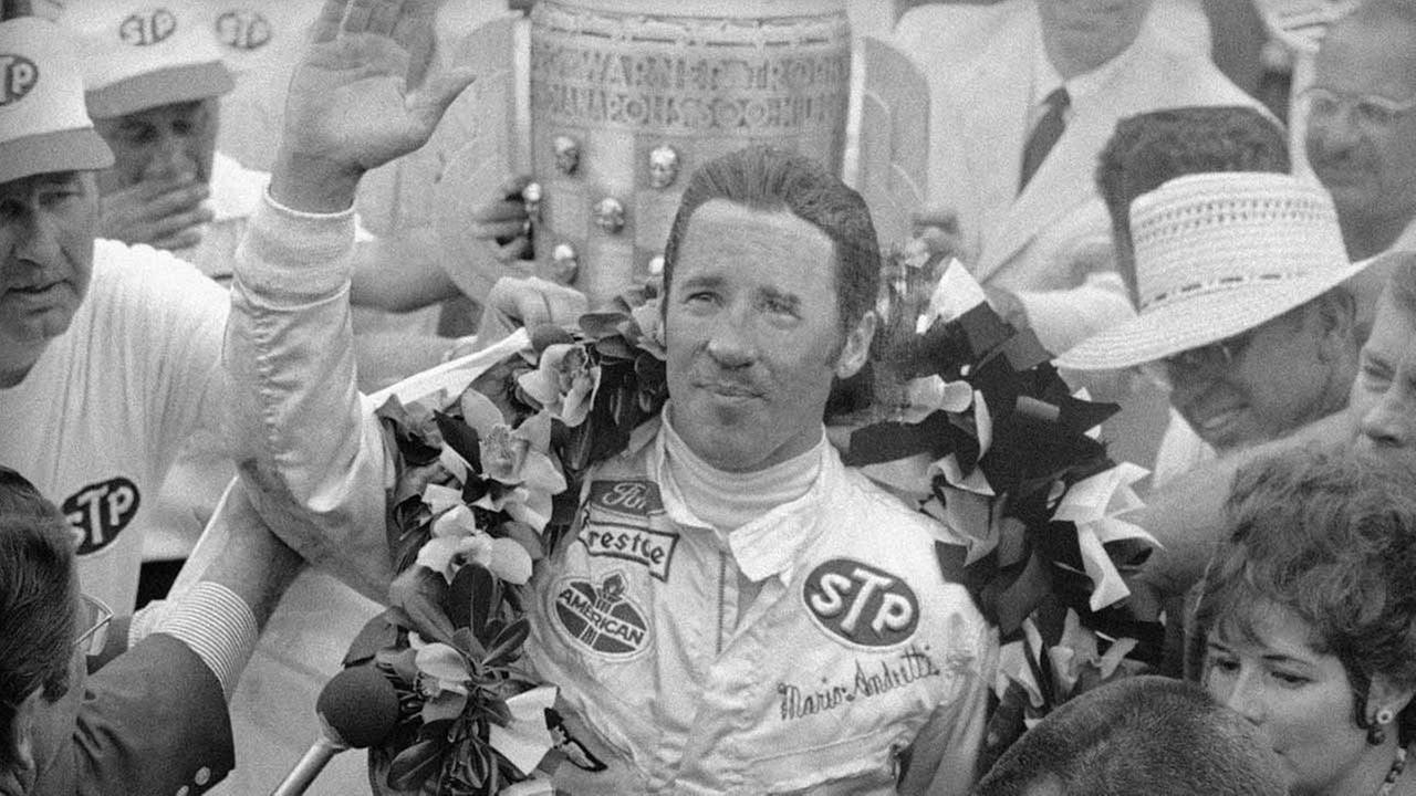 Mario Andretti has a big smile and is wearing a wreath of flowers in Victory Lane after he won the 53rd Annual Indianapolis 500-mile speedway race in Indianapolis May 30, 1969.AP Photo