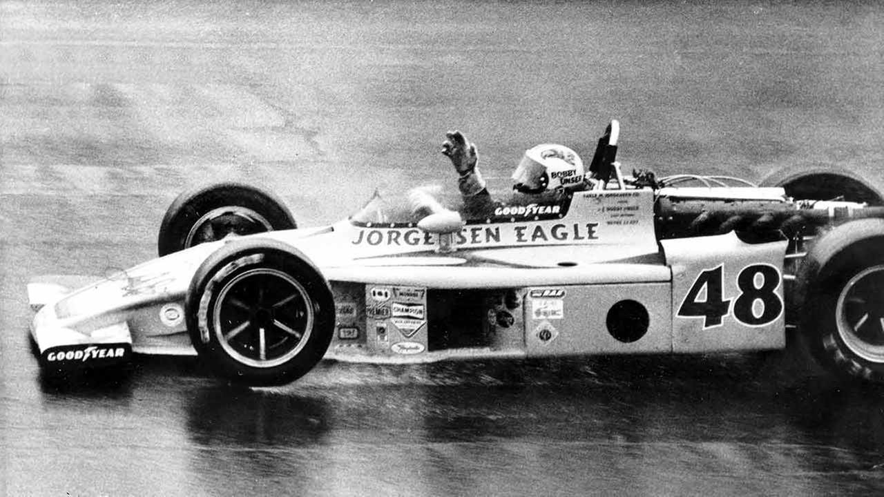 Bobby Unser waves as he cautiously drives his Eagle-Turbo Offy across the finish line to win the rain-shortened Indy 500-mile race at Indianapolis, Ind., Sunday, May 25, 1975.AP Photo