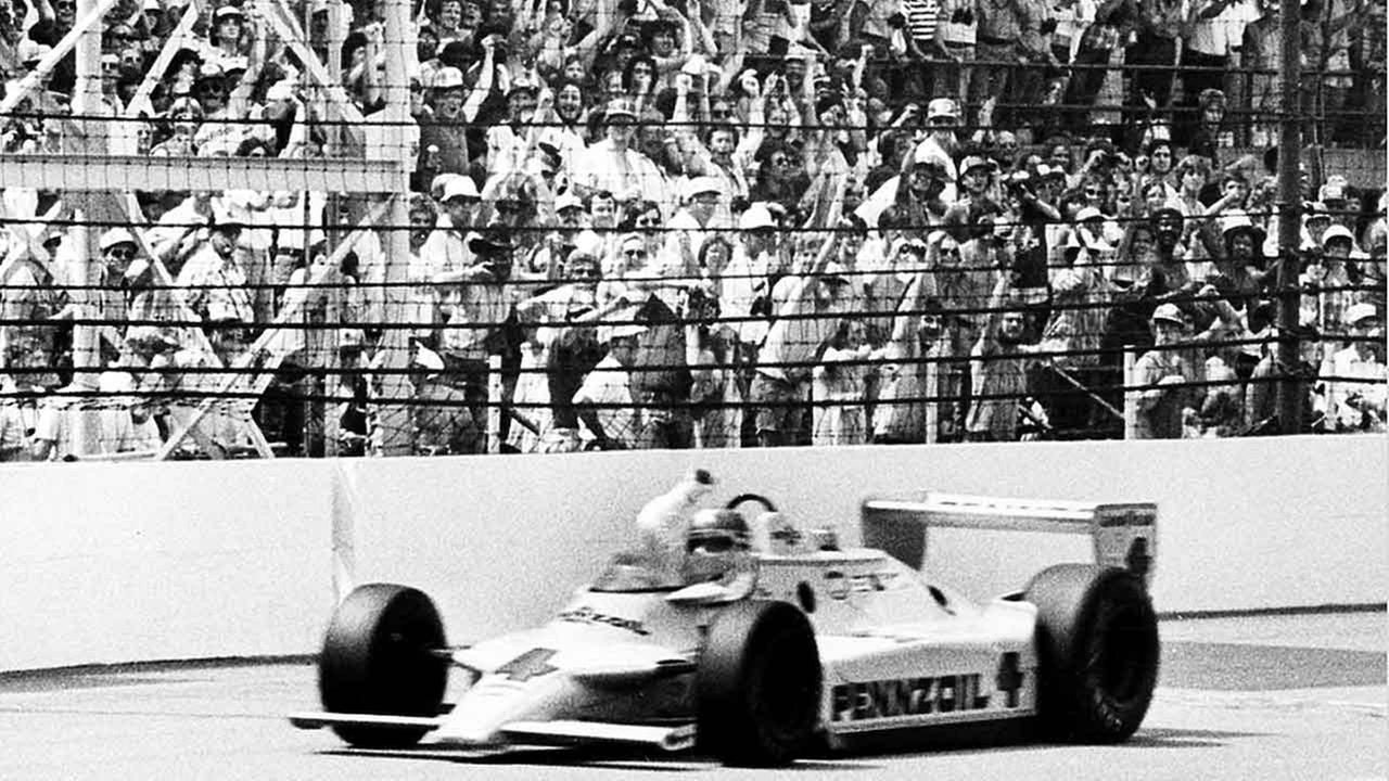 Johnny Rutherford cheers with his right hand as he crosses the checkered flag in his Pennzoil Chaparral after completing the 200th lap of the Indianapolis 500 on May 25, 1980.AP Photo