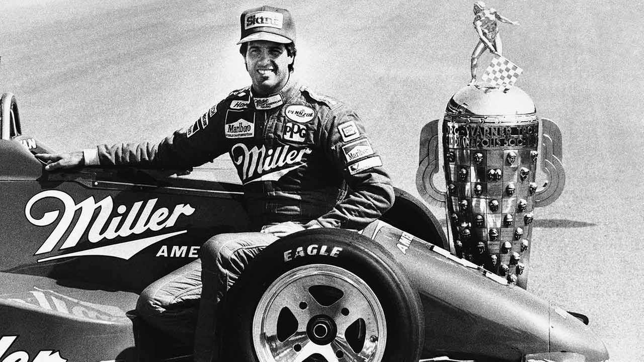 Danny Sullivan of Louisville, Ky., sits on his championship race car during the traditional photographs of the Indianapolis 500 winner on the finish line on May 27, 1985.AP Photo/Michael Conroy
