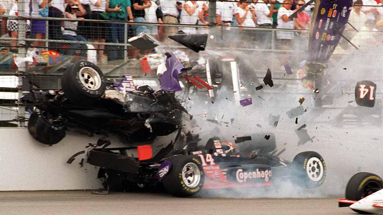The car of Stan Fox, top, breaks apart as it hits the wall following a first-turn collision with Eddie Cheever on the first lap of the 79th Indianapolis 500, Sunday, May 28, 1995.AP Photo/Martin Seppala