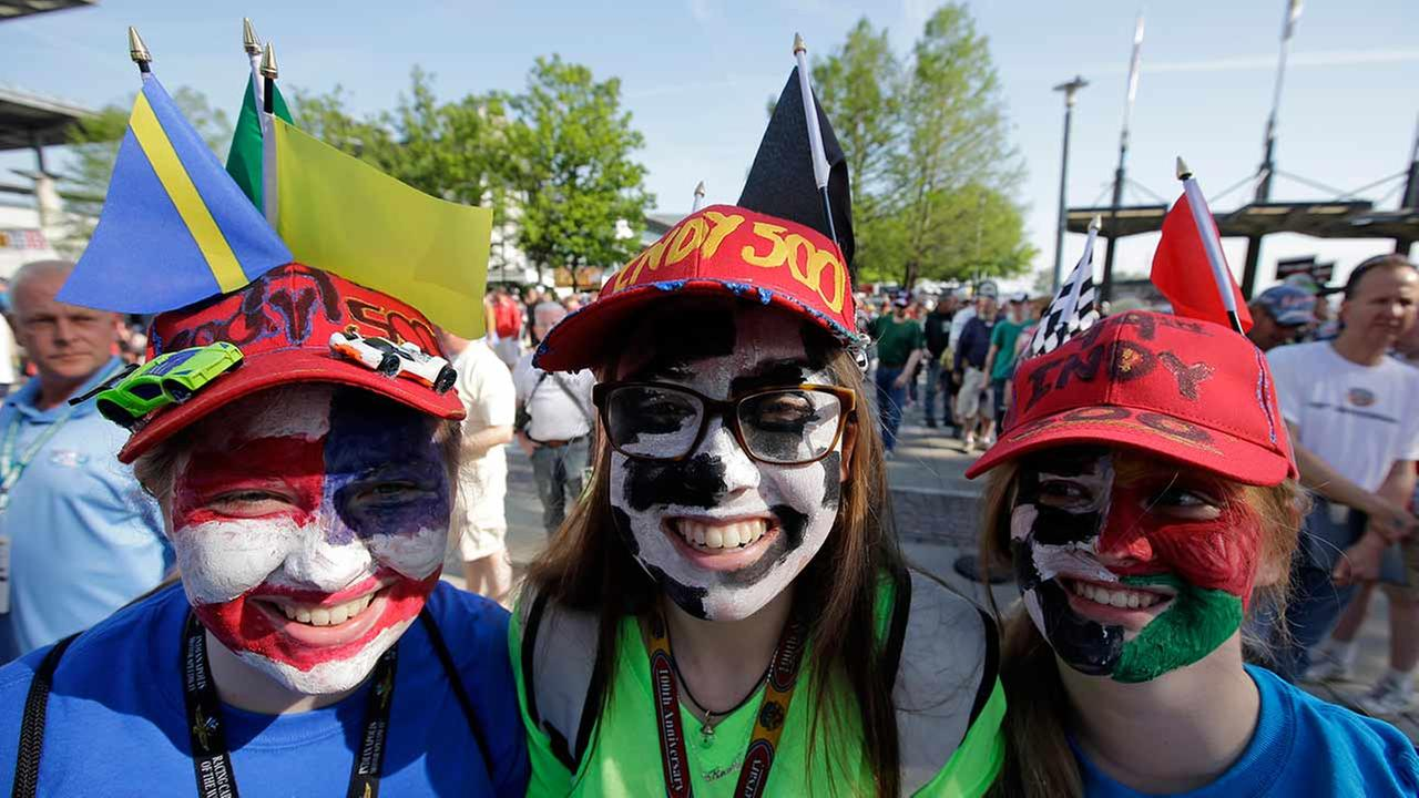 Fans with painted faces gather for a photo during an autograph session for the Indianapolis 500 auto race at Indianapolis Motor Speedway in Indianapolis on May 23, 2015. AP Photo/Darron Cummings