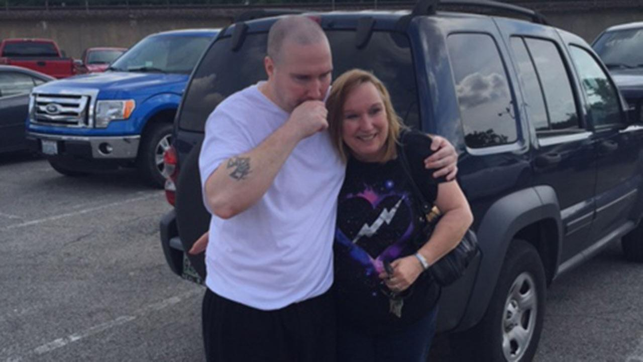 Jason Strong with his mother, Debbie King, after he left the prison facility Thursday.