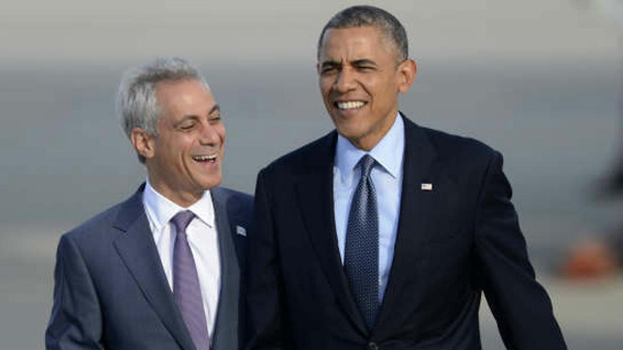 President Barack Obama is met by Chicago Mayor Rahm Emanuel on his arrival at OHare International Airport on May 22, 2014.