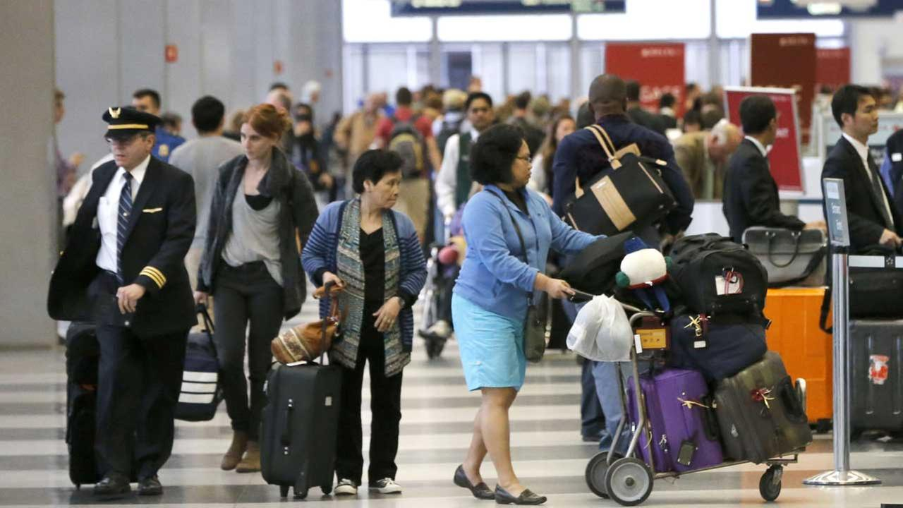 (FILE) Passengers at OHare International Airport.