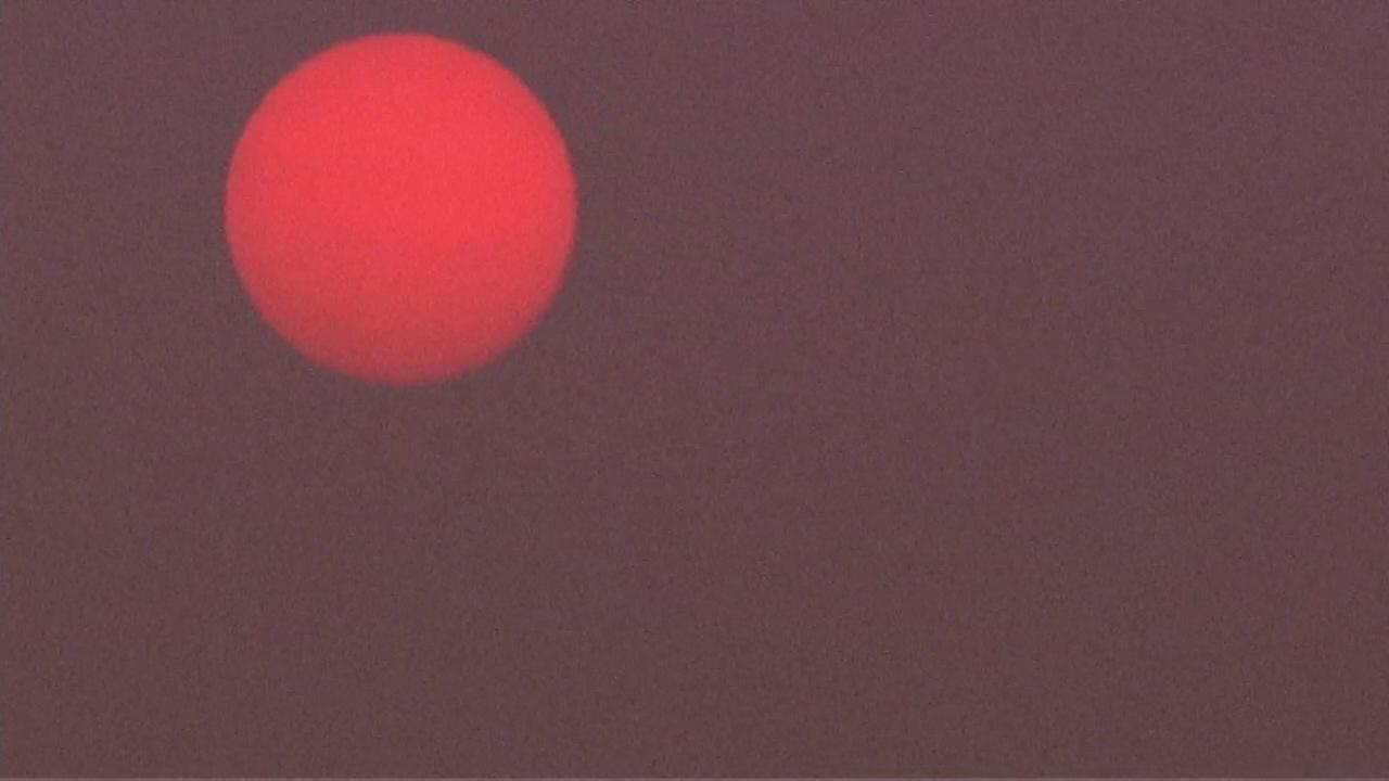 Canadian forest fires behind Chicago's red sun