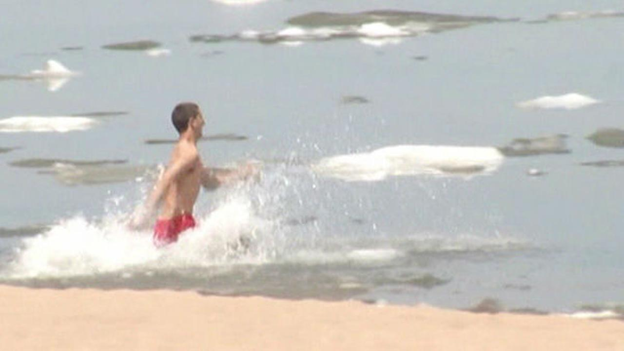Diehard beach lovers brave icy Lake Superior