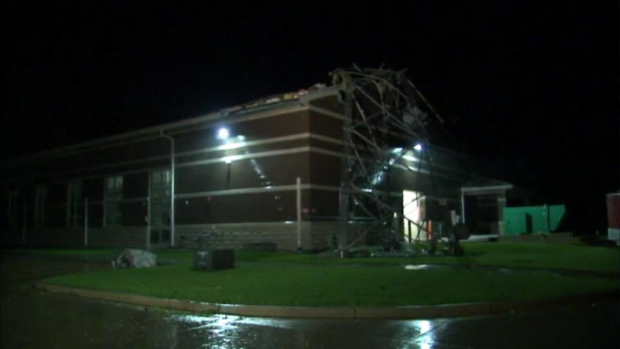 A communication tower has fallen on Fire House No. 2 in Coal City, Ill., after being struck by lightning.
