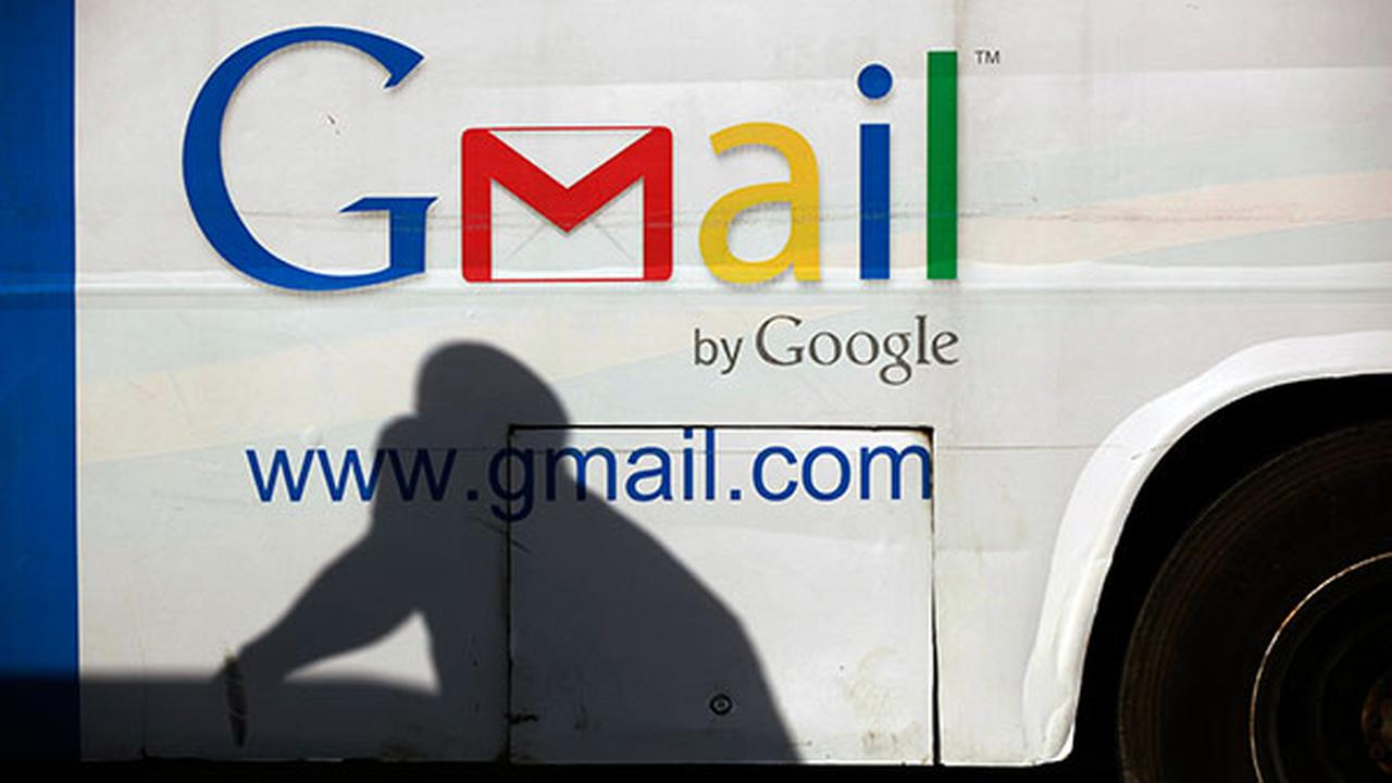 FILE - In this Monday, Sept 17, 2012, file photo an unidentified mans shadow reflects on a commercial bus with an advertisement for Google Mail, in Lagos, Nigeria.