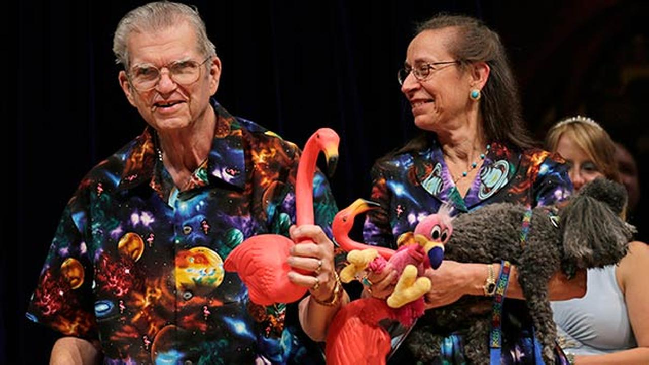 FILE - In this Thursday, Sept. 20, 2012 photo artist Don Featherstone, 1996 Ig Nobel Prize winner and creator of the plastic pink flamingo lawn ornament, poses with his wife Nancy.