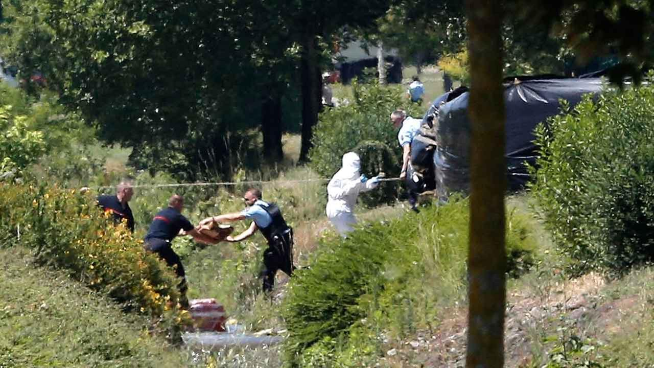 Investigating police officers work outside the plant where an attack took place, Friday, June 26, 2015 in Saint-Quentin-Fallavier, southeast of Lyon, France.
