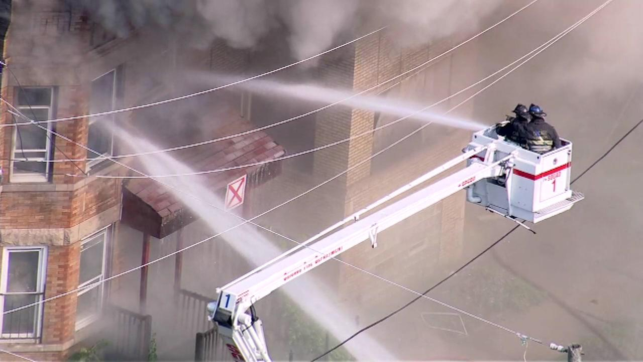 Firefighters battle a blaze at an abandoned building in the 500-block of S. Millard.