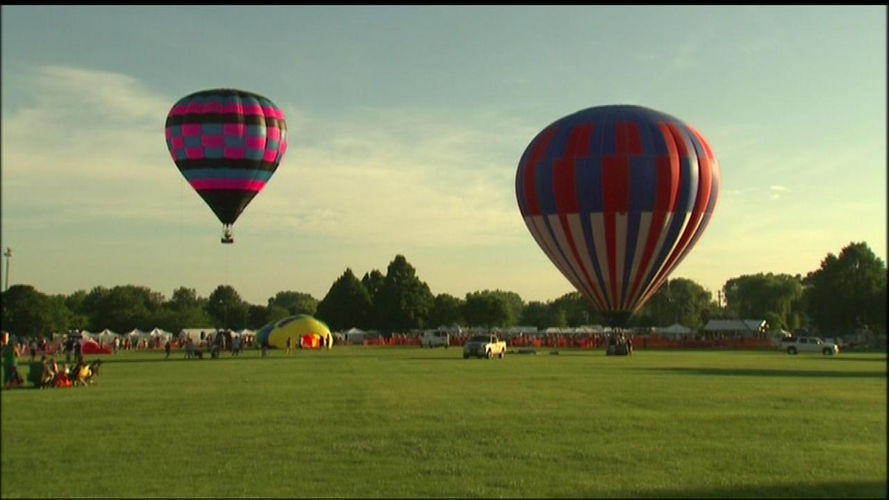 The night sky over southwest suburban Lisle was aglow with hot air balloons Thursday night as the Eyes to the Skies Festival kicked off.