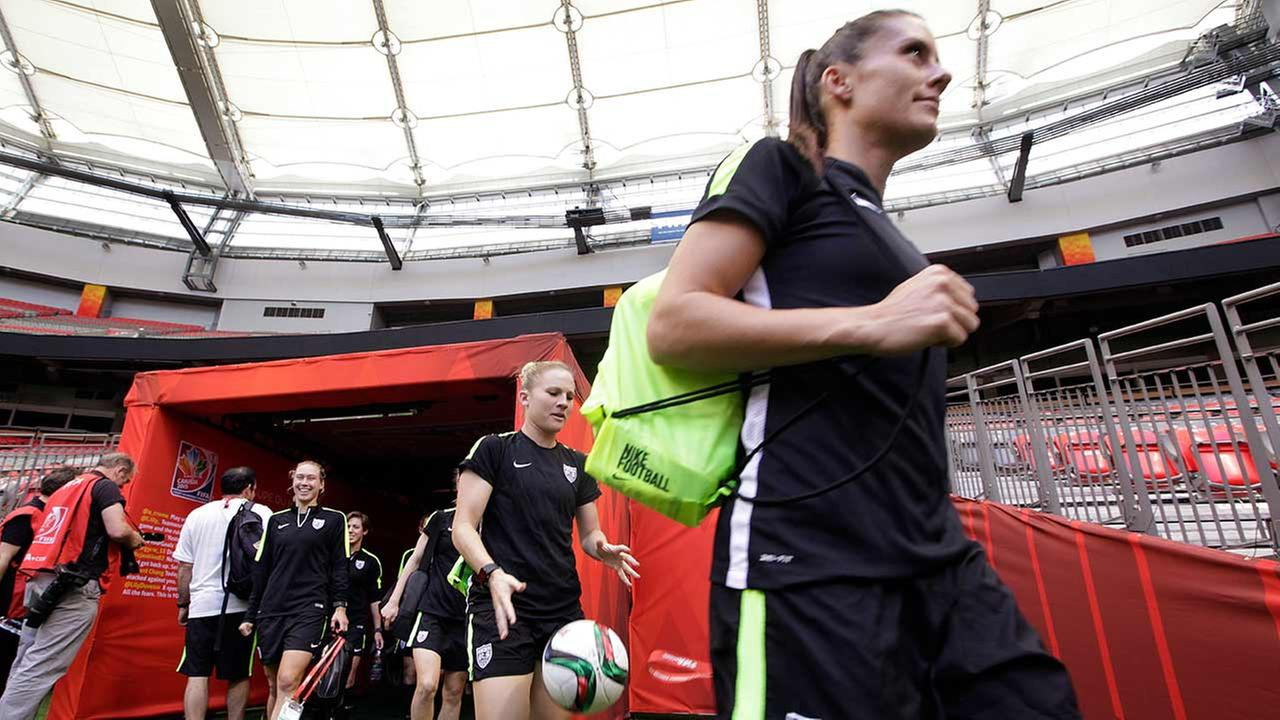 U.S. players head onto the field for a practice for the Womens World Cup soccer final in Vancouver, British Columbia, Canada, Saturday, July 4, 2015.