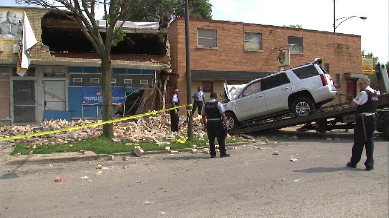 Two men are dead after they crashed into a building when someone opened fire on them on the South Side Sunday.