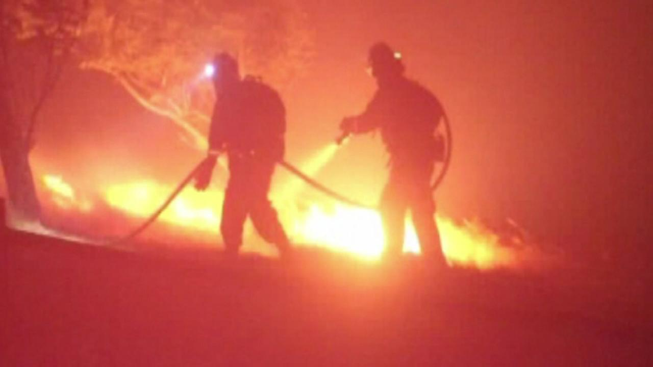 A wildfire that might have been started by fireworks and burned more than 320 acres while threatening homes in the California city of Vacaville was 100 percent contained.
