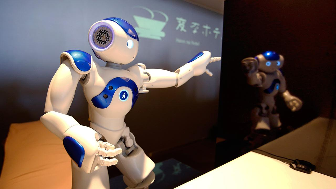 A receptionist robot performs during a demonstration for the media at the new Weird Hotel in southwestern Japan on July 15, 2015.