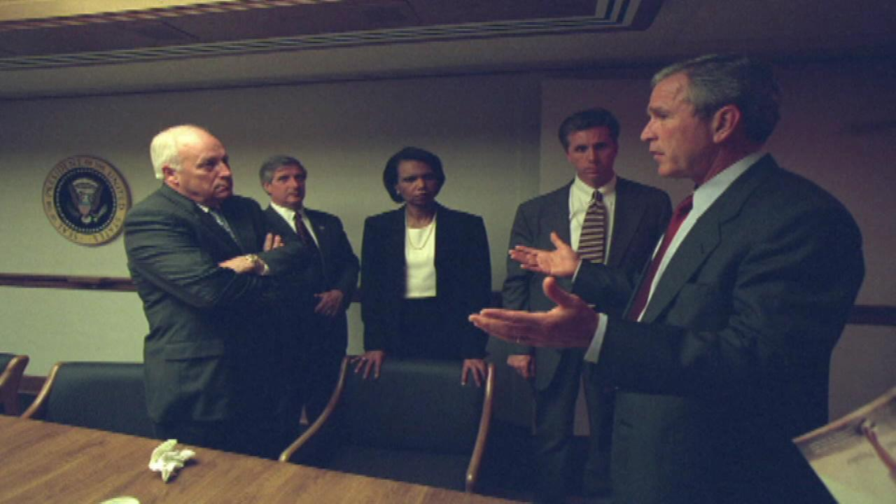 The National Archives has released historic photos of George W. Bush and his administration taken moments after the September 11th terror attacks in 2001.