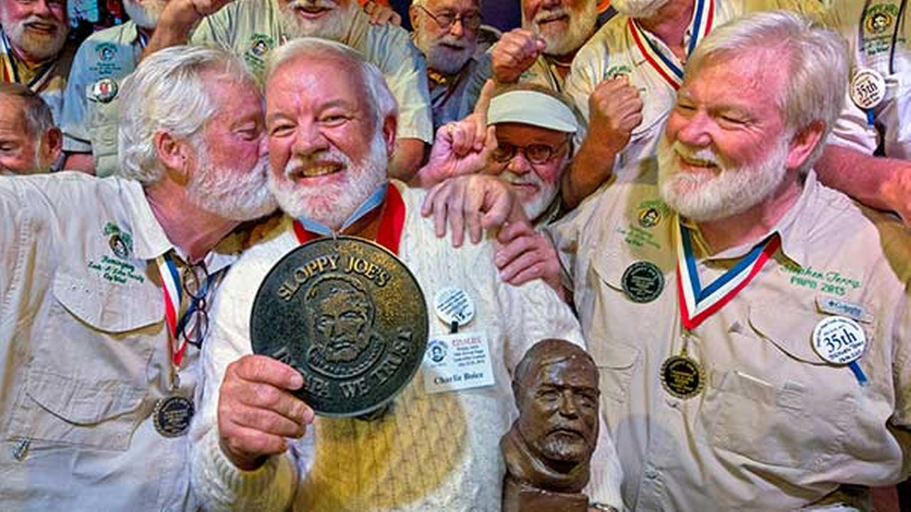 In this Saturday, July 25, 2015 photo, Charlie Boice, center, is congratulated after winning the 2015 Papa Hemingway Look-Alike Contest in Key West, Fla.