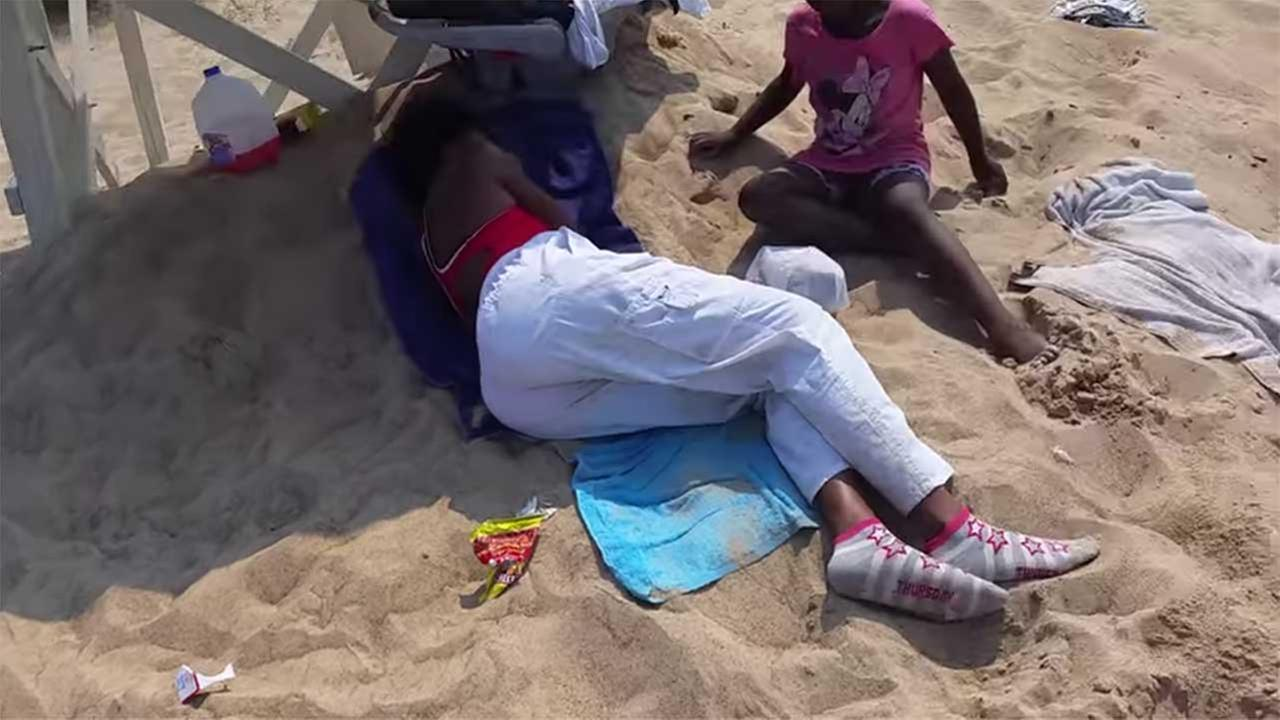 A lifeguard was captured on video laying down in the shade while on duty at Marquette Park beach in Garys Miller Beach neighborhood.