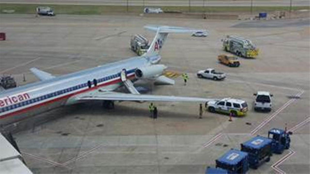 A plane bound for OHare International Airport was evacuated by emergency slide at Dallas-Fort Worth International Airport after reports of smoke in the cabin.