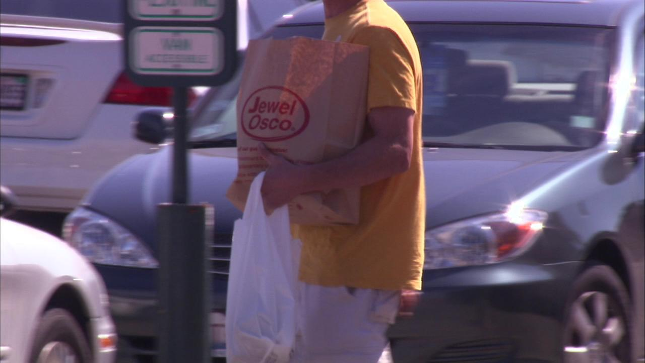 A plastic bags ban many businesses in Chicago and Evanston officially takes effect on Saturday.