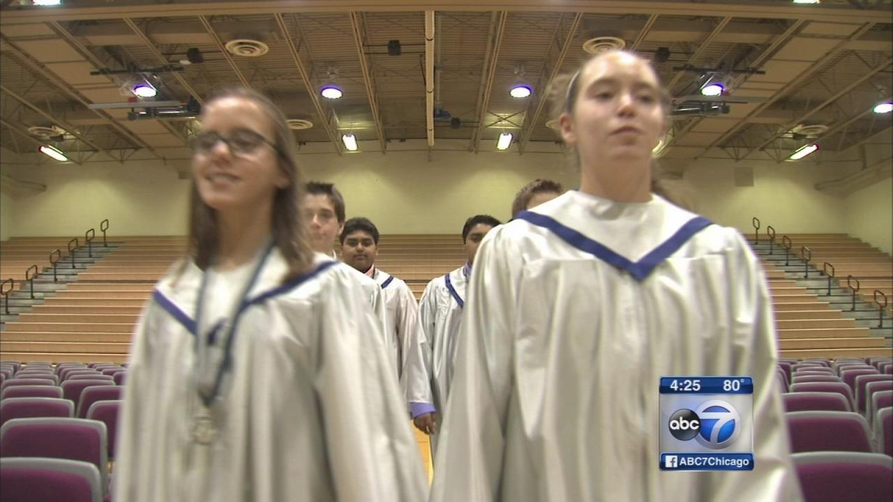 Nine sets of twins graduate middle school