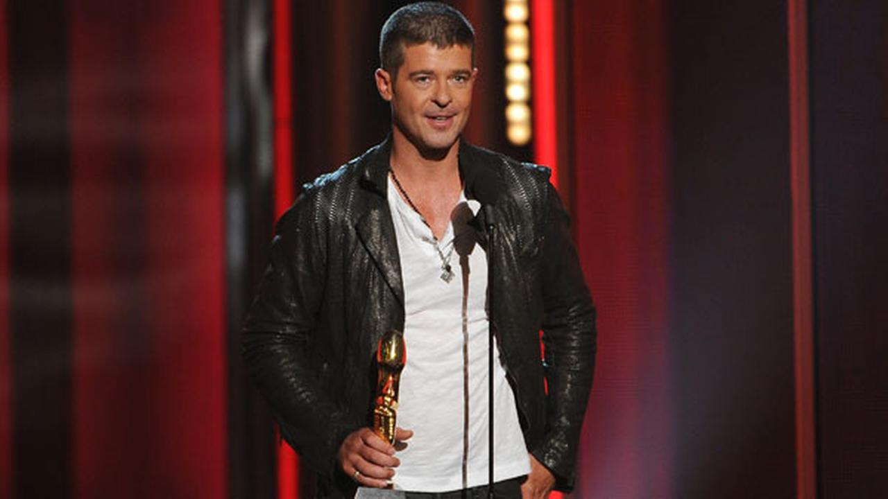 Robin Thicke accepts the award for top R&B song for Blurred Lines at the Billboard Music Awards on May 18, 2014, in Las Vegas.