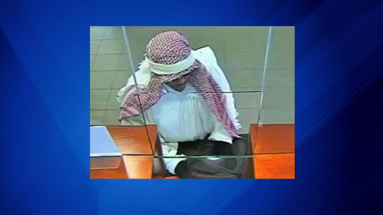 The FBI is requesting help identifying a man suspected in two west suburban bank robberies.