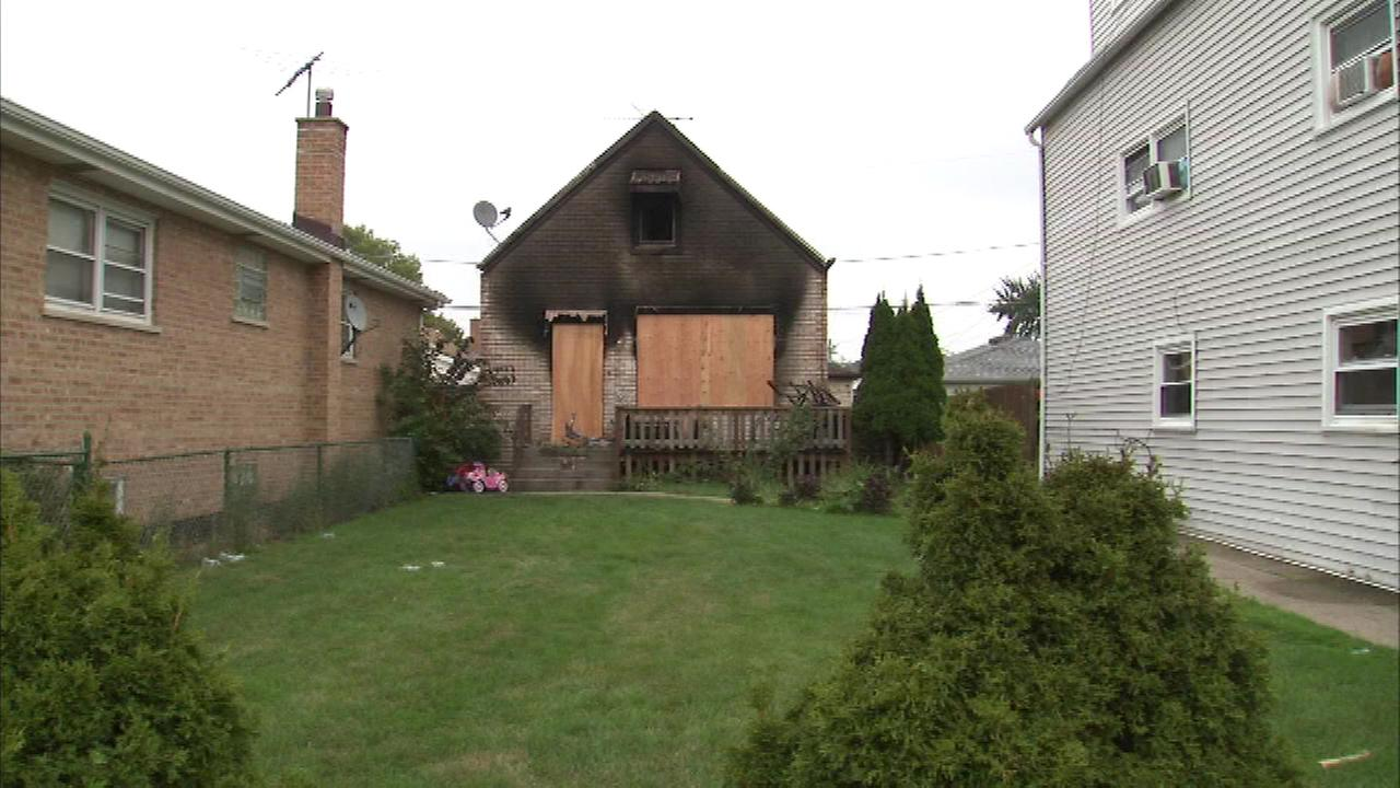 Arson investigators returned Sunday to the scene of a fire that killed two men on Chicagos Southwest Side Saturday morning.