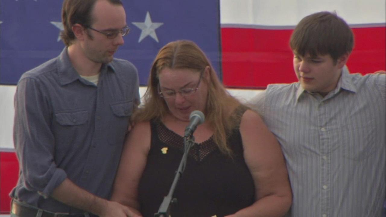 Family members speak during a vigil held for Lt. Charles Joseph Gliniewicz in Fox Lake Wednesday evening.