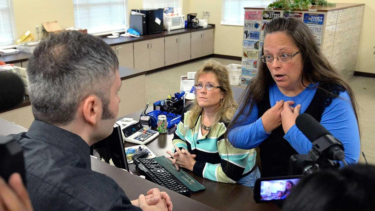 Rowan County Clerk Kim Davis, right, talks with David Moore following her offices refusal to issue marriage licenses at the Rowan County Courthouse in Morehead, Ky.