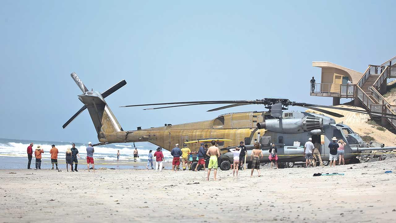 (FILE) In this April 2015 photo, a Marine Corps CH-53E helicopter sits in the sand where it made an emergency landing in Solana Beach, Calif.
