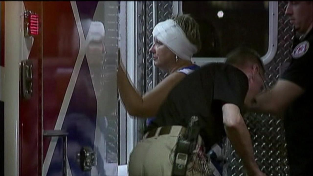 An unidentified woman is helped into an ambulance at Thursday nights Colts game after being by a bolt from the roof.