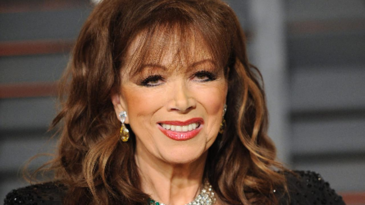 Jackie Collins arrives at the 2015 Vanity Fair Oscar Party on Sunday, Feb. 22, 2015, in Beverly Hills, Calif. Evan Agostini/Invision/AP