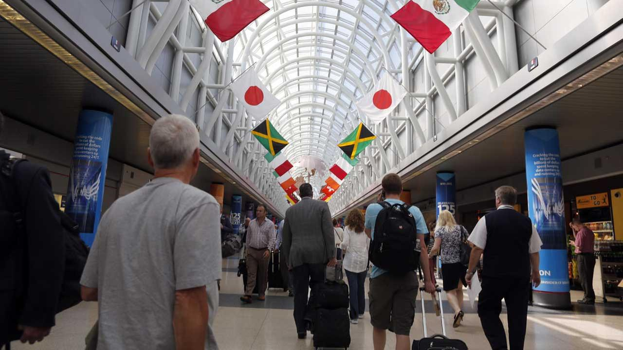 (FILE) Passengers walk through Terminal 3 at OHare International Airport Tuesday, June 16, 2015, in Chicago. (AP Photo/Jeff Roberson)