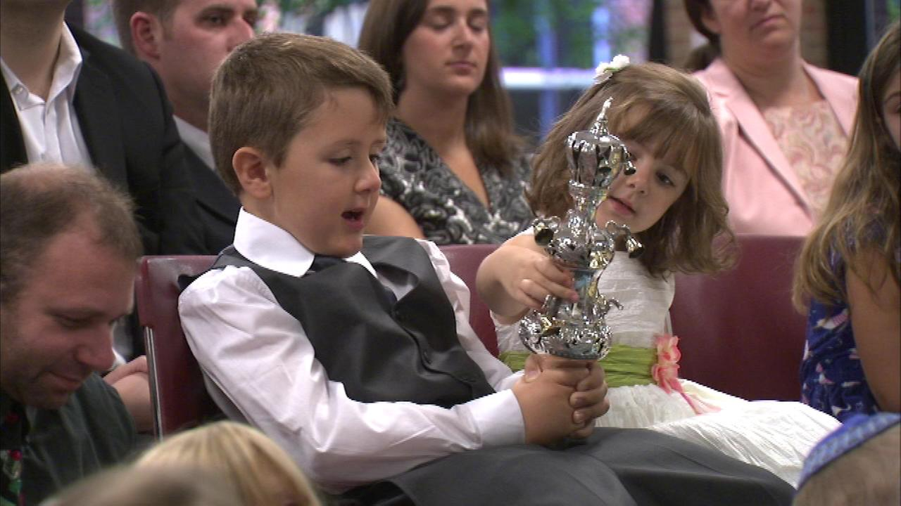 Some families in the northern suburbs marked Yom Kippur at a service in the Evanston Township High School cafeteria.