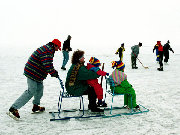 <div class='meta'><div class='origin-logo' data-origin='none'></div><span class='caption-text' data-credit='(AP Photo/Karoly Penovac)'>A family on the frozen lake Balaton enjoys fun on ice near the Hungarian city of Siofok.</span></div>