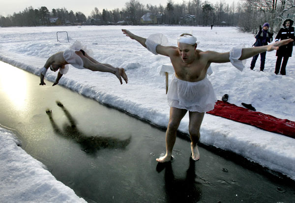 <div class='meta'><div class='origin-logo' data-origin='none'></div><span class='caption-text' data-credit='(AP Photo/Dmitry Lovetsky)'>Winter swimmers wearing ballet costumes of swans from &#34;Swan Lake&#34; plunge into a hole in the ice,  St.Petersburg, Russia, Sunday, Feb. 5, 2006.</span></div>