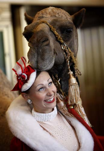 <div class='meta'><div class='origin-logo' data-origin='none'></div><span class='caption-text' data-credit='AP Photo/Seth Wenig'>Rockette Candace Jablonski looks up as a camel named Sally touches her head at Radio City Music Hall in New York.</span></div>