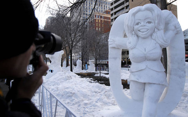 <div class='meta'><div class='origin-logo' data-origin='none'></div><span class='caption-text' data-credit='(AP Photo/Nam Y. Huh)'>A man takes a photo in front of &#34;SnOpra&#34; snow sculpture at Grant Park in Chicago.</span></div>