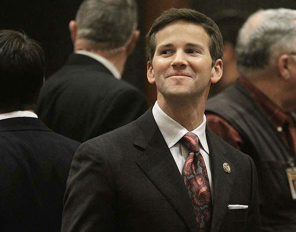 <div class='meta'><div class='origin-logo' data-origin='none'></div><span class='caption-text' data-credit='AP Photo/ Seth Perlman'>(FILE) U.S. Rep. Aaron Schock, R-Ill., who used to be an Illinois state representative, visits the House floor during session at the Illinois State Capitol in Springfield.</span></div>